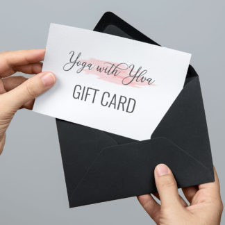 Person removing a Yoga with Ylva gift card from an envelope