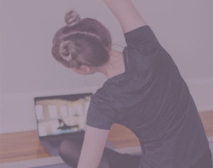 Woman participating in an online yoga class